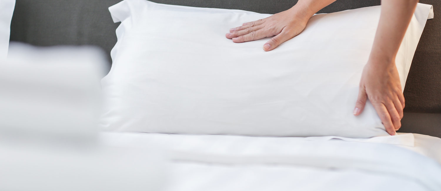 Hands Making Bed from Hotel Room Service | Pacific Hotels